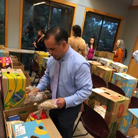 Mario is volunteering by putting food packages together to give away to needy families through the generous support of the Hispanic Bar Association of Austin.