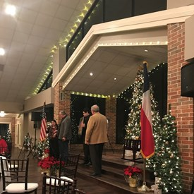 Commissioner Jack Cagle and Texas Senator Paul Bettercourt were the MCs at the Cherry Tree Christmas party.