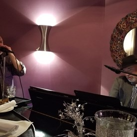 Work hard, play hard! Signature collector Andy Meehan at the afterparty, singing and playing at Black Horse Tavern piano bar in Newtown, PA.