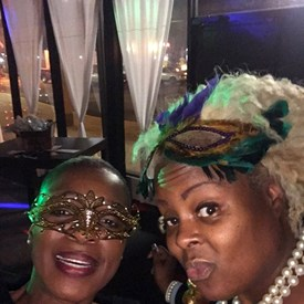Batina and Christine, enjoying the festivities at the Masquerade Fundraiser Event.