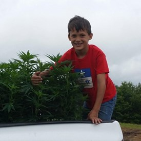 Colten Polyniak helping plant hemp in 2014.