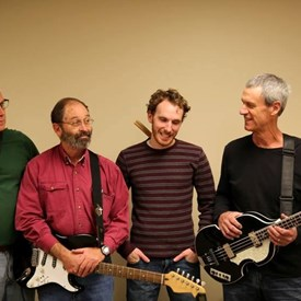 Dr. Wright and his band, Crooked Smile and the Retainers, play classic rock and R & B.