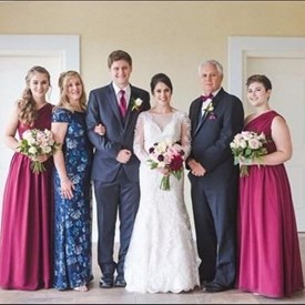 This is Dr. Wright with his family on his son Nicholas' wedding day.  L-R: daughter Rosemary, wife Karen, son Nicholas, daughter-in-law Isabelle, Dr. Wright, daughter Julia.