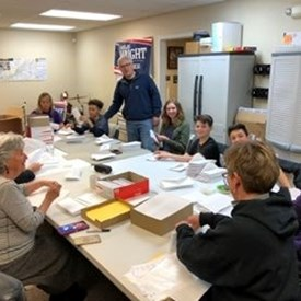 Our volunteers were busy putting our direct mail project together at Campaign Headquarters. They enjoyed a pizza and coke fulled evening.  Thanks to all who helped!