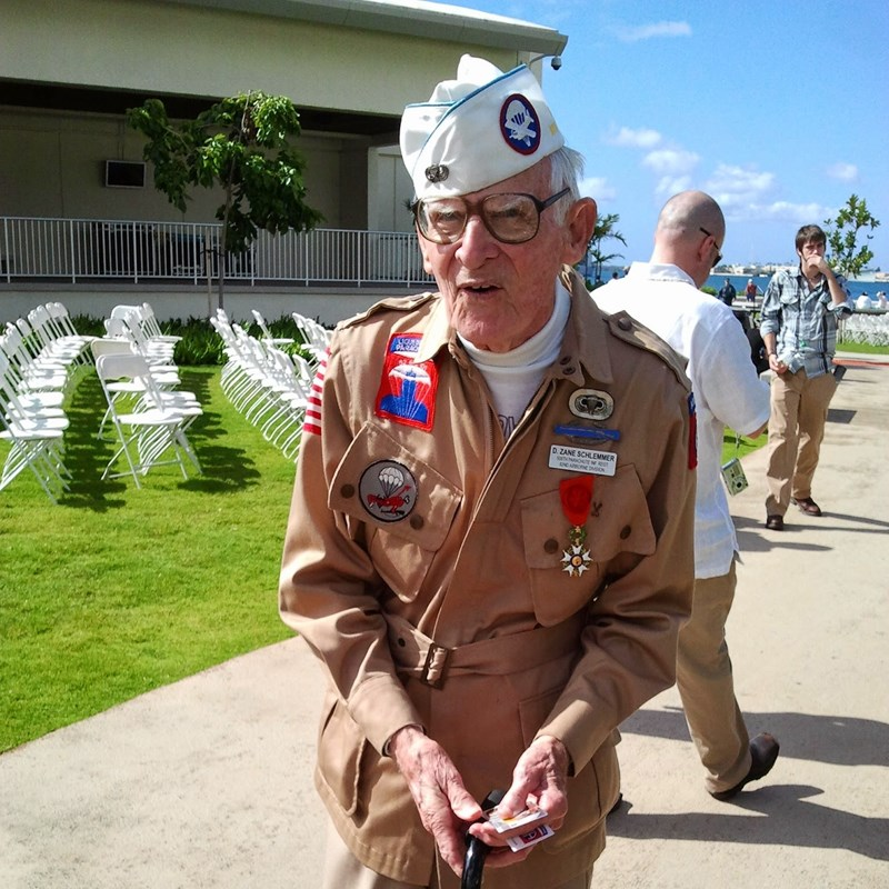 Zane Schlemmer. 101st also was in Battle of the Bulge. He landed in Piquaville and the town named a street after him. Rue Schlemmer. He lived in Hawaii so he was always out at Pearl Harbor Day.