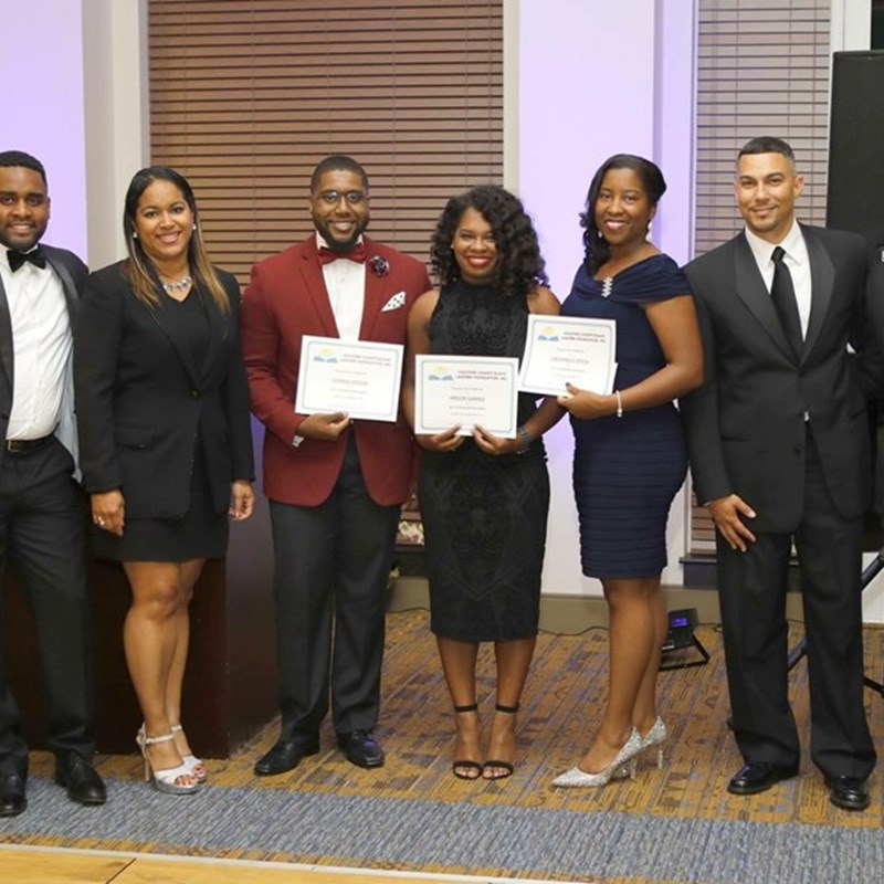 Awarding three Elon Law students scholarships with the Guilford County Association of Black Lawyers