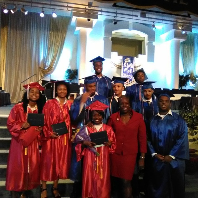 Diedra with graduates of the National Christian Academy after having given the commencement address.