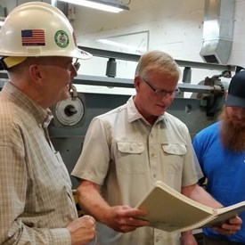 Steve Smith, Training Director for the Sheet Metal Workers Apprenticeship program and Josh Mazella, instructor meet with Dave to discuss the program.