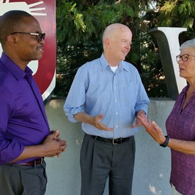 Francis Adewale, Dave Wilson and Carol Landa-McVicker discussing education at the downtown university campus.