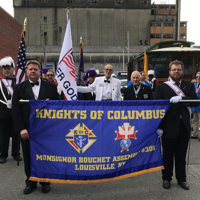 Mike, in the center with white jacket, was in the Pegasus Parade with his brother Knights of Columbus.  Pictured on Mike's left is his spiritual advisor, retired Brigadier General of the US Army, Rev. Fr. Patrick Dolan.