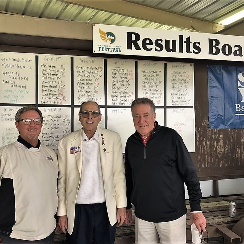 The celebration of the $1 Million Hole in One contest of the Kentucky Derby Festival at Seneca Golf Course was frequented by Mike with former Ford co-workers, Rodney James and Bob Hatfield.