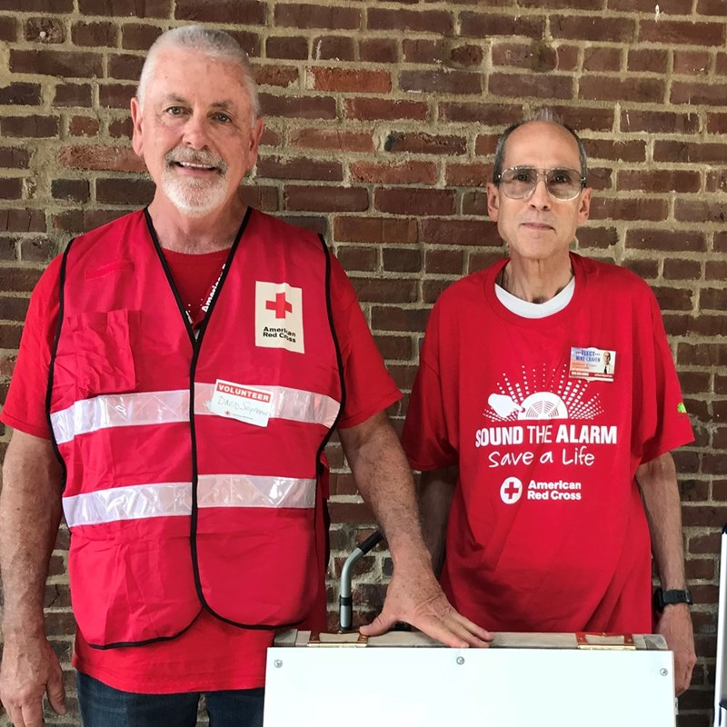 Mike is pictured here with a member of the American Red Cross volunteer committee to help install smoke detectors in the California neighborhood of west Louisville.