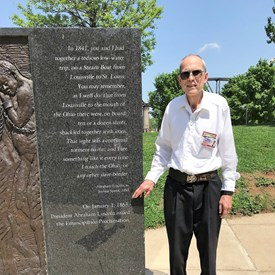 Mike is pictured here down at the Louisville Waterfront next to the Abraham Lincoln memorial, pointing to a plaque of a memory of  President Lincoln in which he abhors slavery. The Emancipation Proclamation which ended slavery in the U.S. was issued by him on January 1, 1863.