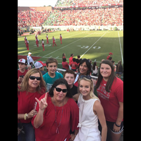 At a NC State Wolfpack football game, Judge Ray is a lifetime Alumni of NC State University. Judge Ray's daughter Meredith is a graduate of NCSU and her daughter is Elizabeth is currently a sophomore at NC State.