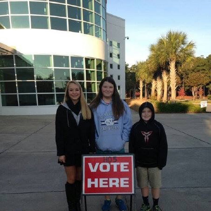 Judge Ray with her children. Everybody supporting Daughter, Meredith on her first time voting.