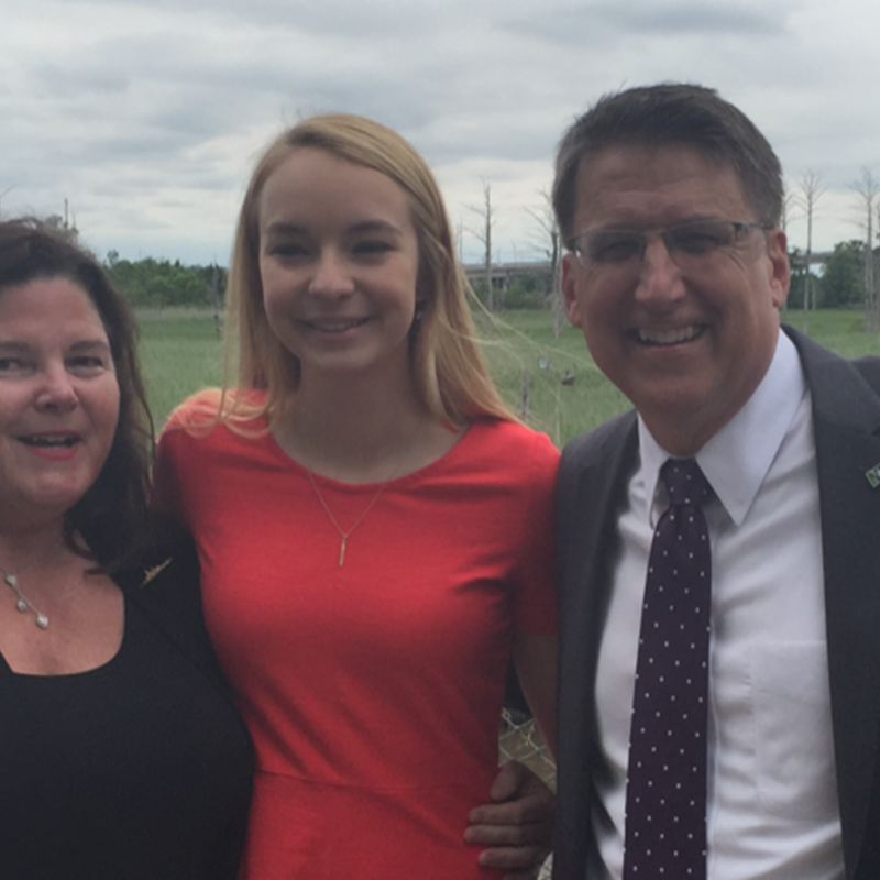Judge Sandra Ray and daughter Meredith with Governor Pat McCrory. Judge Ray was the first woman appointed by Governor McCrory as Chairman of the USS North Carolina Battleship Commission 2015-2016