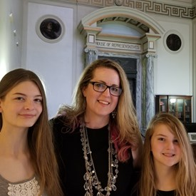 Sarah Carnes are joinged by her daughters Savannah and Julienne at the State Capitol as she registers her candidacy for HB 47 Representative.