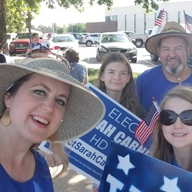 The Carnes family celebrating at the Freedom Festival Parade on Independence Day (July 4, 2018).