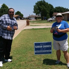 Kevin Stout and Michelle Barnes knocking on doors in Mustang (6/23/2018).