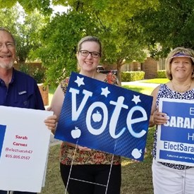 Dr.Paul and Joy Mobley volunteer to door knock and place signs in Tuttle on Saturday (6/09/2018).
