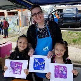 Sarah Carnes and children having fun at the art tent, 2018 Dia de los Ninos Festival, Southwest 29th District, OKC (4/29/2018)