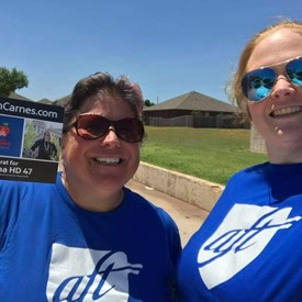 Volunteers Michelle Barnes and Ashley Wilson (rocking their fabulous AFT t-shirts) and canvassing to elect Sarah Carnes in Mustang, OK (6/03/2018).