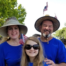 Sarah Carnes, Miss Carnes, and Jeramy Carnes, Freedom Festival Parade on Independence Day (July 4, 2018).