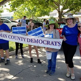 Canadian County Democrats in the Freedom Festival Parade on Independence Day (July 4, 2018). Linda Edmonson (in red) and Chantelle Cory (in tan) with the Carnes family.