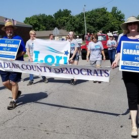 Canadian County Democrats in the Freedom Festival Parade on Independence Day (July 4, 2018). Jeramy Carnes and Sarah Carnes holding the horizontal banner.