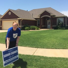 Super volunteer Ashley Wilson places a yard sign in a HD 47 constituent's home (6/10/2018).