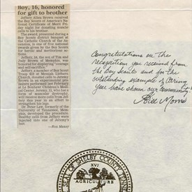 A newspaper article from the Commercial Appeal acknowledging Jeff's National Certificate of Merit for donating muscle tissue to his brother Jeremy and a note from Shelby County Mayor Bill Morris