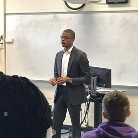 Speaking to a group of high school students during career day in 2017.
