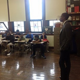 Speaking to a group of students about pursuing a careers in banking and financial services.