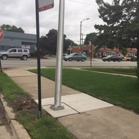It appears that this installation was problematic. Not just because of it's placement on a sidewalk, but it's relation to the no parking/tow zone sign.