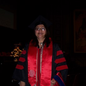 Graduating and receiving my Ph.D. in Education