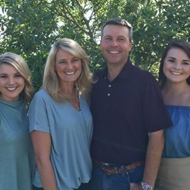 Dr. Brad Buckley pictured with his wife Susan, and their children Emily, Erin, and Bo.