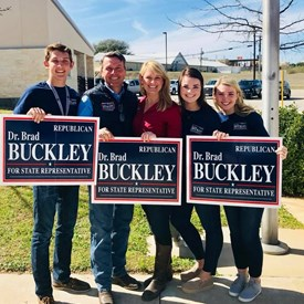 Dr. Brad Buckley pictured with his wife Susan, and their children Emily, Erin, and Bo while campaigning.