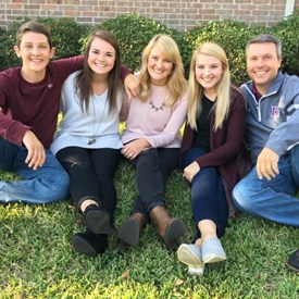 Dr. Brad Buckley pictured with his wife, Susan, and their children Emily, Erin, and Bo.