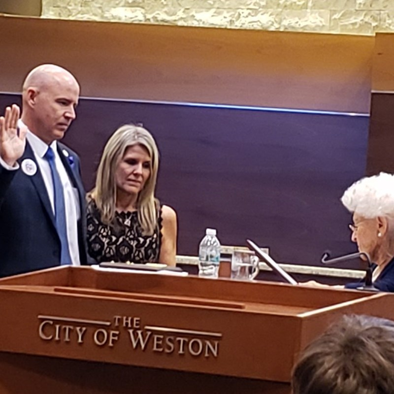 "Attending the city commission meeting where our new city manager, Don Decker, was sworn in by the ""Mother of Weston""."