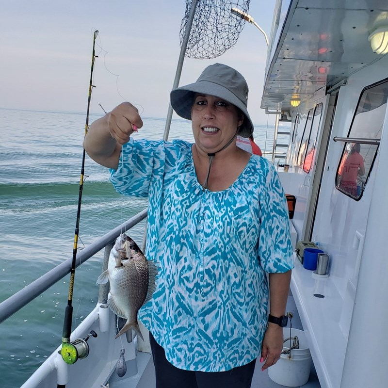 Yvette fishing in Greenport, Yvette is a strong advocate for the fishing industry.