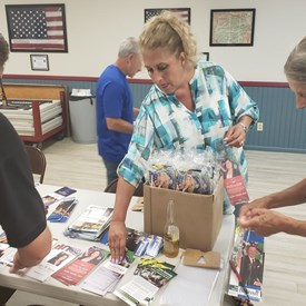 Yvette with members of The Riverhead Republican Committee creating walking packets.