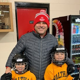 Bill with nephews Cam Hanley and Joey Bergantino at the Waltham Youth Hockey Mites Beanpot.