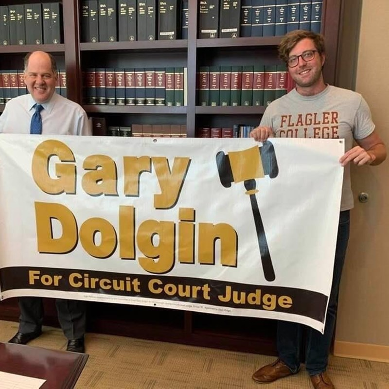 Gary and Michael Newberger display the campaign banner.