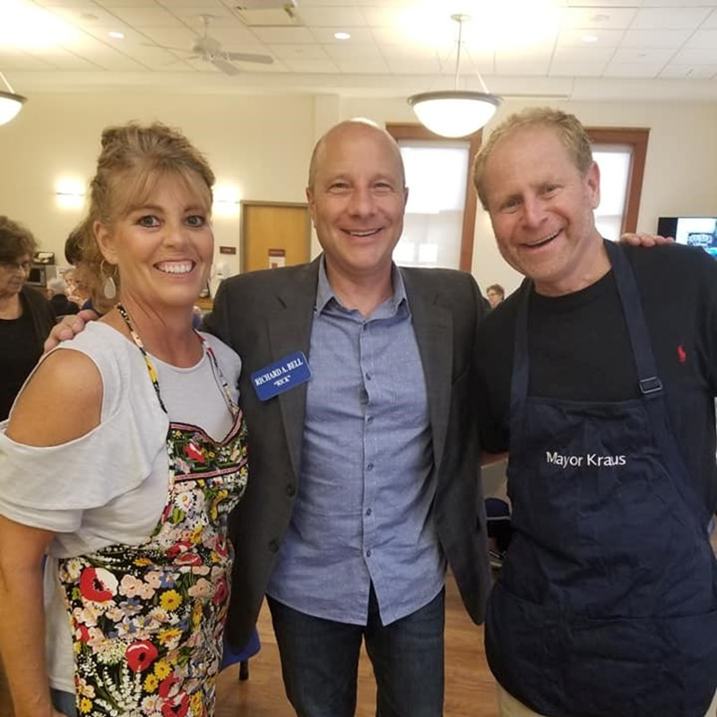 Serving food at the Solon Senior Center for Sally's Salad Bar luncheon with Mayor Ed Kraus.
