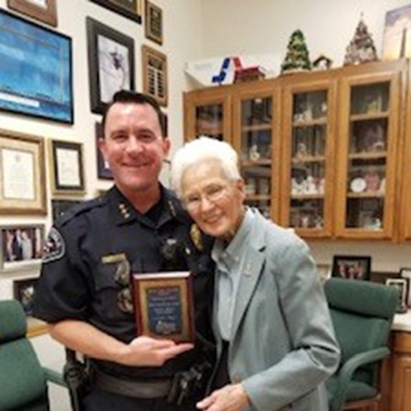 Tillie Burgin presented Constable David Woodruff with an award for his continued support of Mission Arlington.
