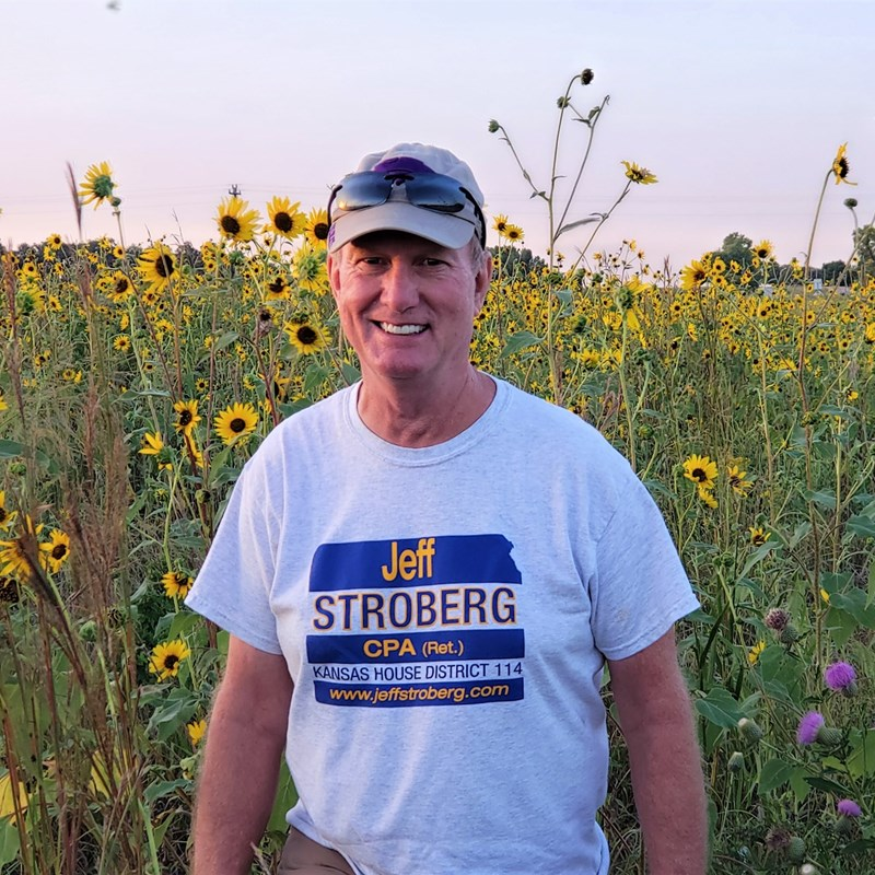 Jeff, stopping to enjoy Kansas' wild sunflowers, while out knocking on doors to meet voters.