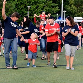 Cyndi, her husband Kirk and their son Jacob leading the parade of athletes at the Special Olympics state games