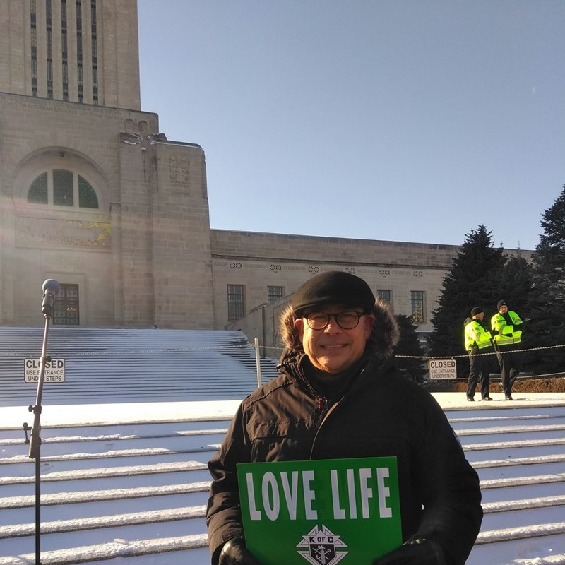 David, a proud pro-life candidate in front of the State Capitol