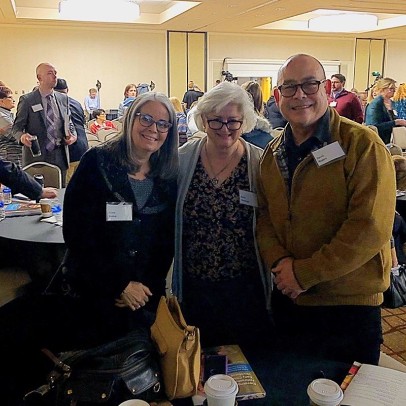 Lynne Brehm, Associate Vice President Early Childhood Mental Health, Betty Medinger Senior Vice President and David sharing a table at the event.