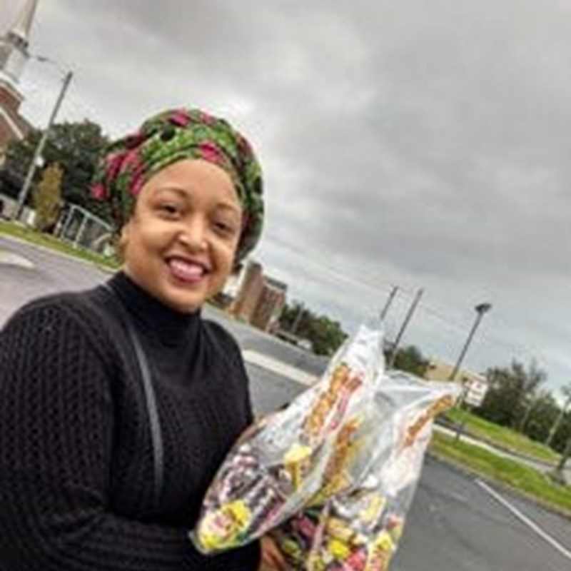 Co-host Dr. Dasha Lundy receiving candy drop-offs from the community for the Burlington DUE Something event.
